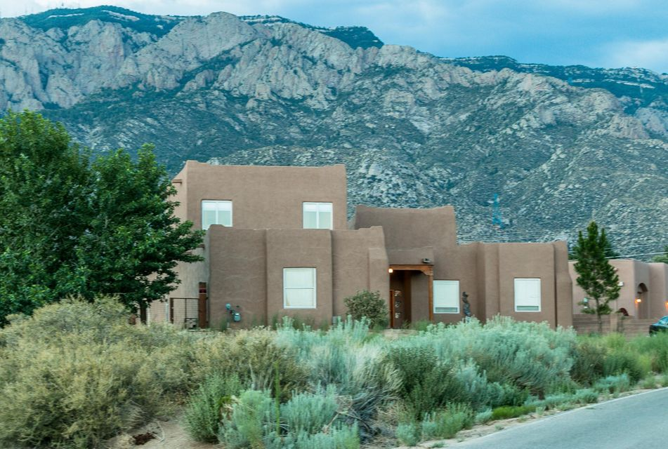 Stunning views of the Sandias & close to hiking/biking trails in the foothills! Strategically positioned on .89 acres to capture exceptional mountain views, this well-thought out home is the ideal blend of comfort and extravagance. Even if you're working in the well-appointed kitchen w/ granite & stainless steel appliances, you'll still be spoiled by the views! Luxurious master suite on main level & separate from other bedrooms. Two addl bedrooms & bath, plus 2 living areas, formal dining & office on the main level. Upstairs enjoy spectacular city lights & mtn views from the 2nd master bdrm/guest suite or teen-ager's dream room with loft/study area & bathroom! Horse stall/barn, private backyard, 3-car garage, your own well (not shared!) & sought after area make this your ideal next home!