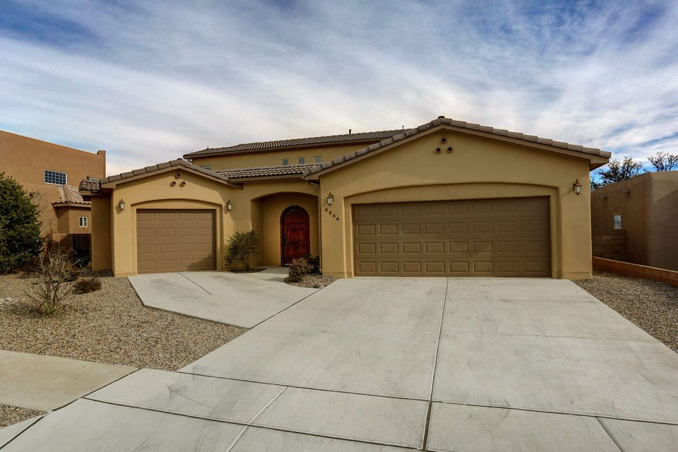 If you want a New Home without the wait or the price tag then look no further. This Beautiful Custom Built Luxury Home, with quick access to Paseo Del Norte & Coors Blvd, was born in 2014. This Home features City & Mountain Views, a Downstairs Master Suite, an attached Office/Casita, Refrigerated Air, Radiant Heat, Iron Stair Case & Balcony, a Gourmet Kitchen, Granite Counter Tops, Travertine Backsplash, Tile Enclosed Showers, Jetted Tub, Wood Doors & Baseboard, Tankless Water Heaters and 3 Garage Spaces. The Open Floorplan, Covered Patio, Open Balcony, Huge Kitchen Island and Fireplace set the mood for entertaining. This Home was built to NM Green Standards and you will not believe the utility bills once you see them. Schedule a private showing today.
