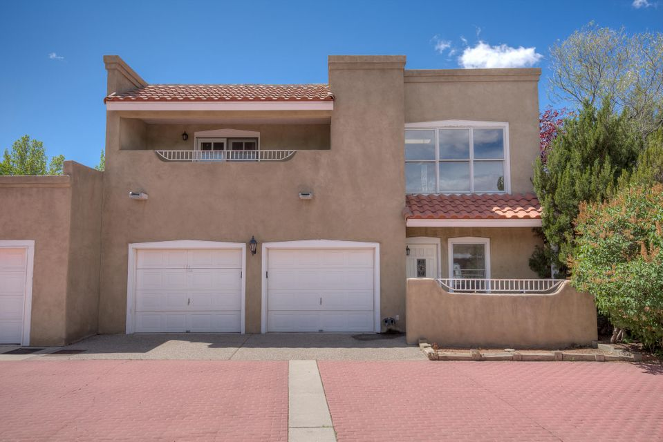 Beautiful North Valley Neighborhood with quiet streets, relaxing walking areas, inviting plaza and private park! This is a wonderful community! This townhome has a great open floor plan with raised ceilings, new carpet, all tile on main, enclosed patio with hot tub, 2 Fireplaces, large master suite, freshly paint, low maintenance back patio with built-in stainless steel grill. Large Kitchen with breakfast nook, island, and pantry. Radiant floor heating on first floor and baseboard heaters on second level. Beautiful wood railing staircase at entry, separate dining room, large great room with vaulted ceilings and custom fire place, powder room down, two full baths up. Mature cottonwoods throughout the community. Great Neighbor Hood & Fantastic neighbors! Welcome Home!