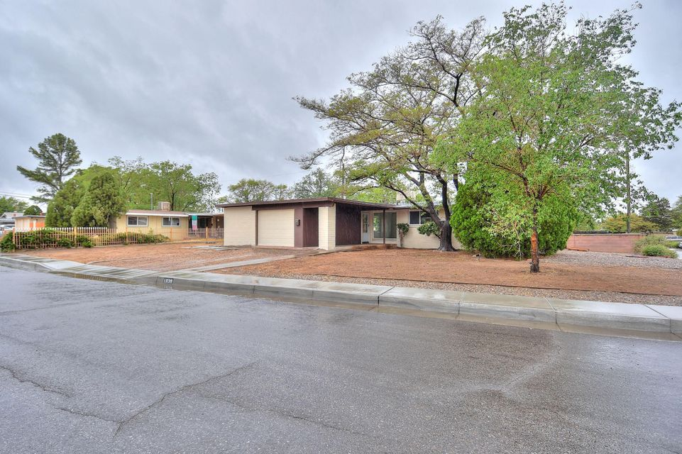 Don't miss this move in ready home with updates throughout! Upgraded kitchen with granite counters, tile backsplash and stainless steel appliances.   Tile throughout main living areas and bathrooms. Newer roof, Master Cool evaporative cooler, water heater and vinyl windows (2015).