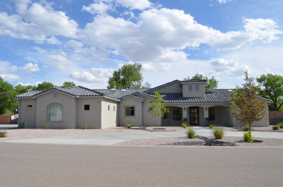 Don't miss your opportunity to own this beautiful custom home on a half acre lot! Only 30 days left until this home will be taken off the market. This home boasts an open floor plan, wood beams, 10 & 14ft ceilings. It is perfect for entertaining with a 16ft pocket door that leads to a huge covered patio with outdoor cooking area and built-in grill. The neighborhood has direct access to the Bosque Trails, bike trails, and is in close proximity to Old Town, restaurants, museums, and entertainment. Don't miss out on this truly remarkable home.