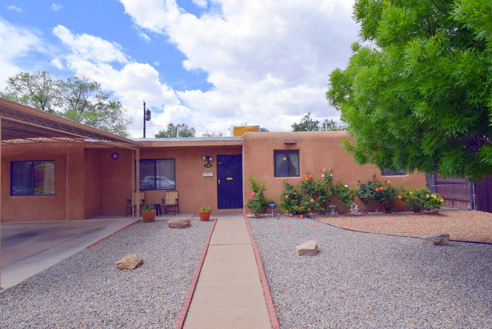 Great, established NE Heights neighborhood and a home just waiting for a new owner! Show ready and well maintained, you will find two separate living spaces, one can be combined living/dining room and the other a large, comfy great room. The kitchen has newer appliances, and the baths have been updated. Newer carpet in the bedrooms, Laminate in living rooms, and tile in baths. There is a large laundry service room with tons of storage. Many of the windows are replaced. Outside you will find a large yard with storage shed, side yard patio, and privacy height fencing. There is so much here to love!