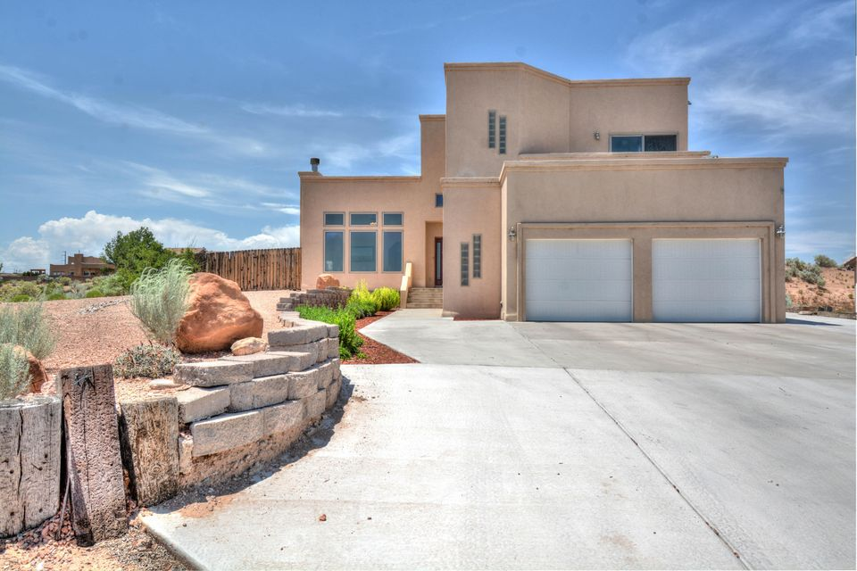 Custom 2 story Southwest Style beauty located in Rio Rancho Estates on a half acre! With 2,930 sq. ft. this home has 4 bedrooms, 3 full bathrooms and 2 living areas. The formal sitting area hosts a center fire place and 3 large windows showcasing the magnificent views of the Sandia Mountains! Gourmet kitchen with an abundance of upgraded cabinets, upgraded counter tops, center island with a built-in wine rack, built-in desk/work space and a breakfast nook. For a more formal dinner there is also separate dining area right off of the kitchen. Large master with a balcony overlooking the mountains. The master bath hosts a large jetted tub, separate shower and double sinks. Enjoy sunsets from the covered porch, extended pergola and fully landscaped back yard. This home is truly a beauty!