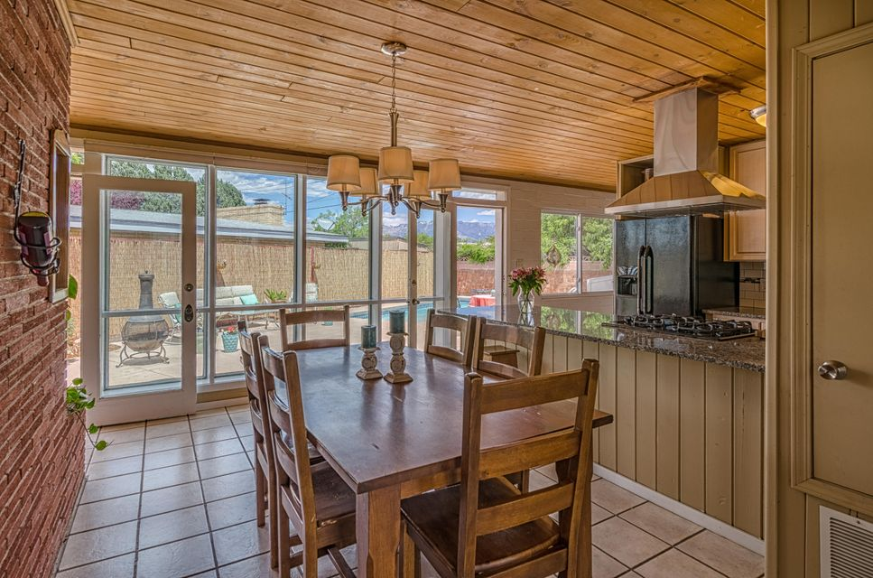 Summer is here and welcomes you to your own private Oasis. Wonderful UNM area home, in Altura park area, near schools, shopping, Nob Hill, downtown, Kirtland AFB and ABQ Uptown. Remodeled kitchen with tile floors, solid wood cabinets with slide out shelves, and granite counter tops. 2 separate living areas, wet bar with kitchenette, remodeled master bathroom, separate laundry room with folding area, office or 4th bedroom and loads of storage. New carpet, fresh paint, 2 fireplaces, and updated windows throughout. Floor to ceiling windows on North side of home provide phenomenal natural light and opens to beautiful back yard with in ground pool. Large well maintained corner lot with room for a garden and easy driveway access on Jefferson.