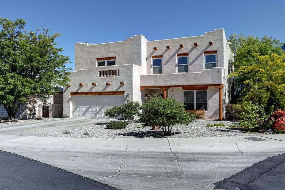 Don't miss this beautiful near North Valley home in the Symphony gated community! Close to I-40, Old Town, bosque walking trails, amenities, & more. This functional floorpan boasts 3 bedrooms, 2 1/2 baths, a loft, large kitchen, and ample living and dining areas. The large kitchen has an island, gas stove, and double ovens. Gorgeous beam ceiling & kiva style fireplace in the main living area. Relax on the masters private balcony. All rooms are oversized & feature walk in closets. Light & bright! Raised ceilings throughout. High efficiency fireplace insert keeps you warm in the winter.  Newer cooler keeps you cool in the summer, but when you see the backyard you won't want to be inside this summer! Beautifully landscaped backyard includes a deck & is perfect for entertaining!  Welcome home!