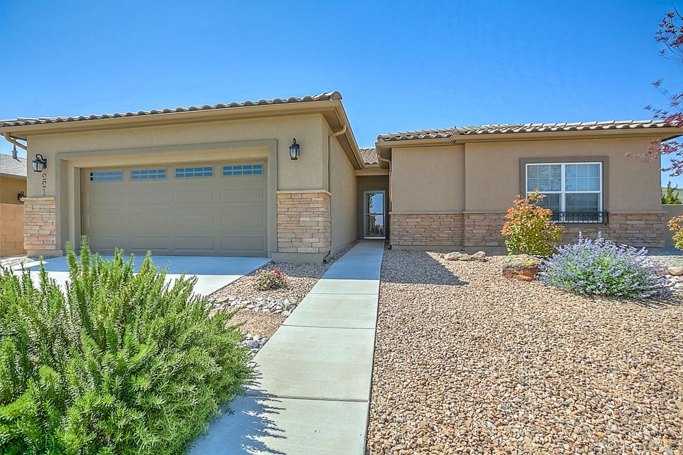Gorgeous Ranch Style home in the Jubilee Active Adult Community! This approx 1949sf home sits on a nicely landscaped  corner lot with beautiful views of the El Cerro De Los Lunas Mountains! Built with custom features and updates including staggered Maple Cabinetry w/ lighting underneath and additional cabinets in Master Bath and Laundry, Hi-Breakfast Bar w/stone face, SS Appl, executive height counters and solid surface counter-tops,extended garage w/shelving and mud sink, Window Blinds throughout, Sola-Tubes in Guest Bath and Foyer, Nest Thermostat, Added window and build-out in dining area, Added build-out in Master  BR, 18'' Tile floors throughout except MBR. Oversized & Insulated 2 Car Garage w/mud sink! Amenity Center: pool, gym, etc! Minutes from ABQ and 1.7 miles west of I-25! MORE.