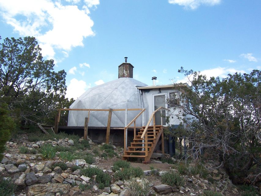 DOME! Fixer upper 500+/- sq ft dome on 1/2 acre in Placitas! This dome was originally part of the commune in the late 1960s/early 1970s in Dome Valley. Basically 2 rooms plus unfinished basement area. Wonderful 13' tall curving ceiling! Wood floor! Sloping property with plenty of trees, beautiful views and close to National Forest land! No restrictions. Owner will finance with a reasonable down payment. This is a very good area for wells; private well is 230 feet deep, originally estimated at 100 gallons per minute! Septic was installed in 2007. Ideal place for artists! This is a very eclectic part of Placitas!