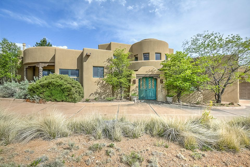 This phenomenal home by Rutledge is nestled on a great view lot high up in High Desert.  Majestic views of the breathtaking Sandia mountains.  High ceilings and windows bring the views right in...Santa Fe style court yard entry, Gorgeous kitchen with entertaining bar, granite, pantry, sunny breakfast nook, pot fillerOutdoor living includes  a heated gunite pool with cover and a relaxing spa and soothing water feature.The luxurious master suite has a jacuzzi tub, water haven rain shower, California closets and bidet, Two huge bedrooms with a loft upstairs, view balcony for sparkling city lights and warm sunset views.  Vigas, carved post, travertine floors custom iron staircase, rotunda entry, cen-vac, wine room, lighted nichos, media room