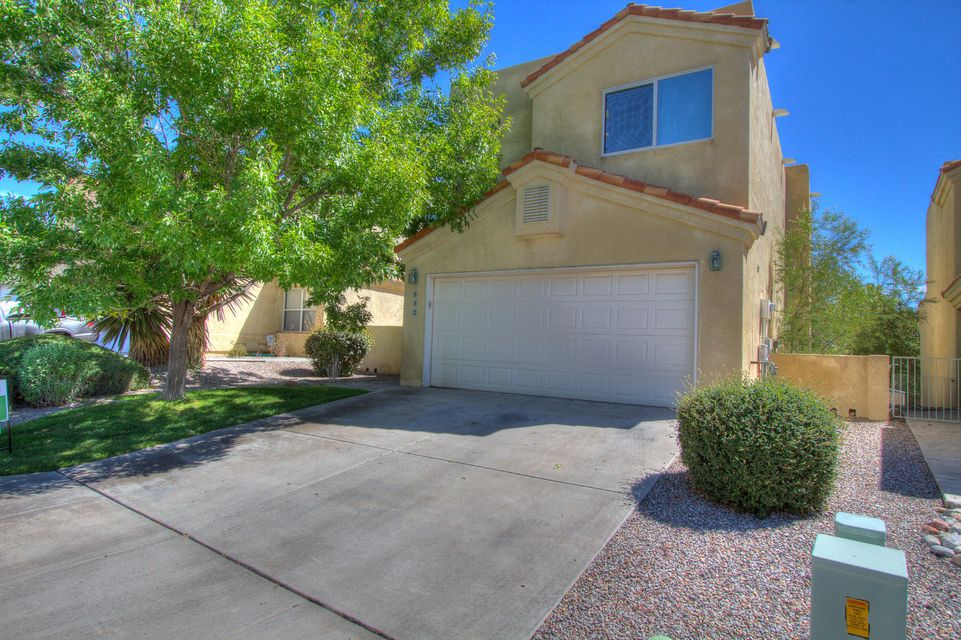 This is by far, the most updated home in the neighborhood! Located in the lovely Renaissance Townhome, all ages- gated community, this detached townhome features NEW laminate wood flooring and trim, fresh paint throughout, NEW carpet upstairs, tile in wet areas and more! Refrigerated air w/ nest thermostat which can be controlled by smartphone to save money and energy. Bright and inviting kitchen with island, breakfast bar, tile floors and all kitchen appliances stay (electric range with gas hookup available). Large master bedroom with walk in closet and private balcony to enjoy the views of the Sandia mountains. Master bathroom has his and her double sink, jetted tub and new custom tile floor. Gas fireplace, ceiling fans and skylights.