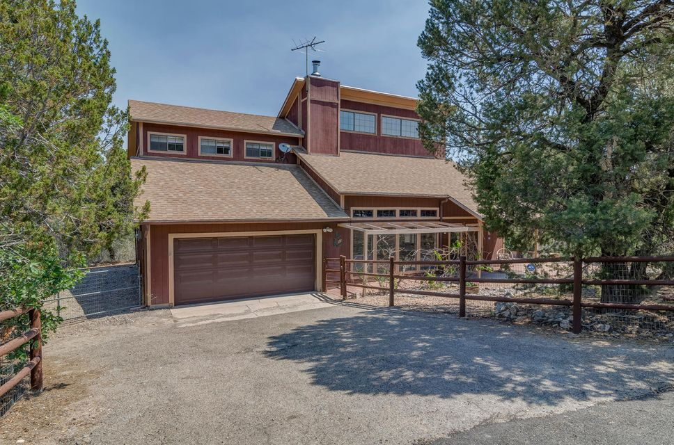 The GOOD LIFE begins at home in this beautifully maintained, mountain home set against nature's backdrop, offering wooded, mountain splendor and tranquility yet only 17 minutes from ABQ! Raised T&G ceilings, stunning engineered wood flooring in the living and dining areas, wood stove, newer roof, well, convection oven and refrigerator. Large windows create the sun-drenched rooms. Spacious open deck, Paver Patio, Fenced dog run. A truly charming home with tremendous pride of ownership!