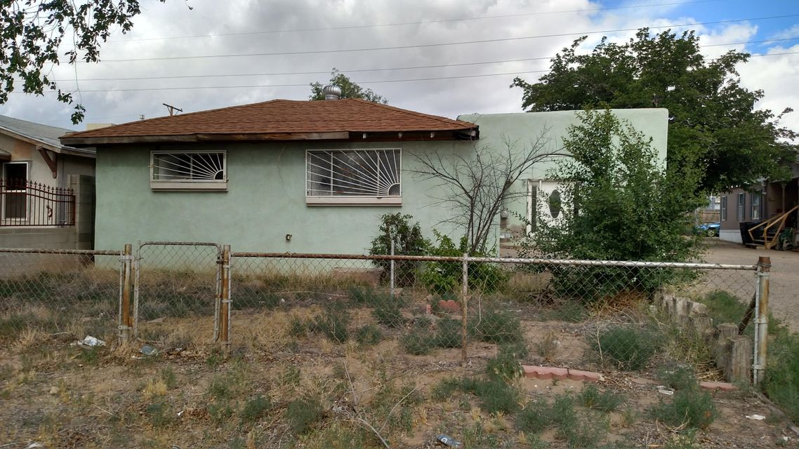 Tons of potential.  Great opportunity for an investor or handy home owner to take this mostly blank canvas and make it shine.  Owner financing available!2 minutes from down town and 5 minutes from nob hill and Isotopes/UNM sports complex.