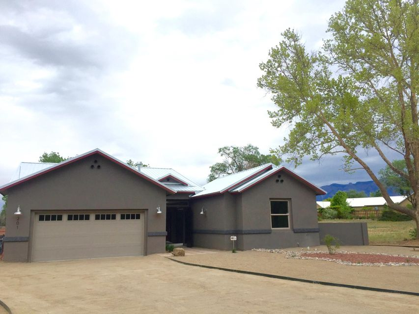 Triple 2017 Parade of Homes award winner! Designed for today's lifestyle, this just completed Lee Michael Homes' design oozes comfort & style, with an interior courtyard connecting a perfect space for a home-office, in-law quarters and more. Stunning NM Industrial craftsman style throughout with glass and quartz & stone on a 1/3 acre lot with tons of outdoor room to relax & enjoy with North Valley charm. Very open with custom cabinets, stunning tile work & roll-in custom showers. Lots of storage & perfect outdoor living space. More lots available here to custom build...