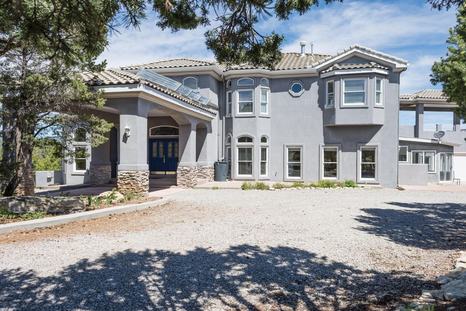 Sweeping Views of 5 Mountain Ranges from this Elegant Custom Home in Popular Woodlands Subdivision. Super Floor Plan with Formal Living Room* Formal Dining* Family Room with 2-story Windows* Large Kitchen with Custom Ash Cabinets* Double Oven* Breakfast Nook* Downstairs Master Suite with Large Walk-in Closet* Other Features include Soaring Ceilings with Crown Molding* Gleaming Hardwood Floors* Fabulous Entry Staircase* Ceramic Tile* Extended Decks and Patios* Bonus Room in addition to Large Great Room* Radiant Heat and Refrigerated Air* Enclosed Porch*5 Car Garage and Workshop Area* On lovely 2 Acre Wooded Lot with Private Gate* Paved Driveway* Shows Beautifully!