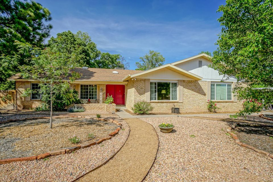 Beautiful, quiet North Valley neighborhood. Adjacent to Bosque and Rio Grande w/biking, walking, and riding trails. This 5 bdrm, 3 bath has an amazing kitchen with custom cherry cabinets, large island, pantry, gas cooktop, option of 3 sinks including (the main) farm sink, granite counter tops, all new stainless steel appliances, under cabinet lighting; brilliant custom glass pendant lights and kitchen opens to the family room with a grand fireplace flanked by beautiful built-in bookcases. Gorgeous hardwood flooring, 2 master suites (one separate from bedroom wing). Living areas are spacious - great for gatherings and offer easy access to outdoor spaces. Don't miss the oversized 2 car garage and two car carport.  Large backyard with ''shop'' buildings. An exquisite Dietz Farms beauty!