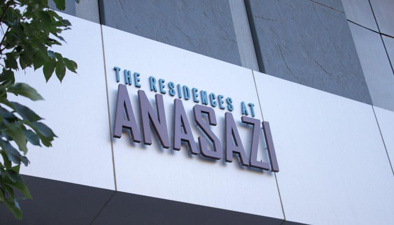 Welcome to The Residencews At Anasazi Downtown. One of ABQ's finest Urban Condo Community. Enjoy this units private balcony with views North, East and West, up and down ABQ's famous Route 66. Views of Downtown and the West Mesa. This light filled unit also has remote controlled window shades. Unit owner on site covered assigned parking and secured card key building access. Stainless kitchen appliances, washer/dryer and trash compactor included. All tile throughout. Quartz countertops and vanities. Full height backsplash. Contemporary finishes throughout.