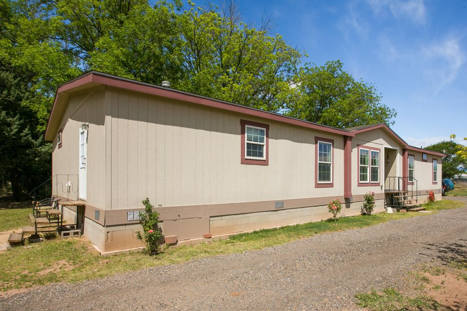 Newer 4 Bedroom Home on 1 Acre of Irrigated Land features Generously Sized Rooms, Wood burning Fireplace and Walk-In Closets in Each Bedroom. Located a short walk away from the County Courthouse, RailRunner Station, Schools, Shopping & More! EZ Access to I-25 for Commute. Nice deck stepping out from the Living Room on the North Side of the Home.