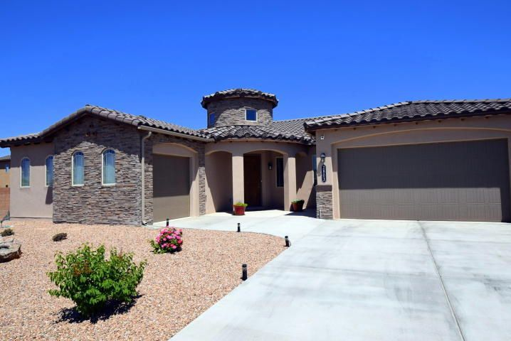 GORGEOUS custom built home on a beautiful corner lot! Impeccable kitchen with granite counter tops, stainless steal appliances and and a beautiful eat in bar. Captivating tile and hardwood flooring throughout the entire home is so elegant. Front and back yard are both beautifully landscaped and the whole home is upgraded to be green.