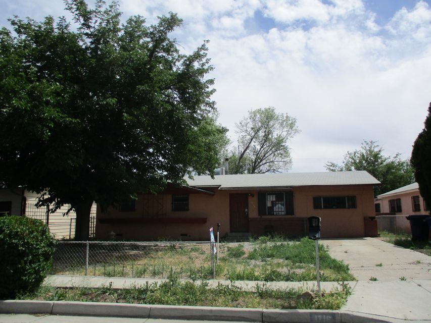 Situated on approximately 0.17 acres with a screened back patio for year around use. Some of the features include wall to wall carpet, floor to ceiling brick fireplace, wall of windows, wood paneling, and comfortably sized bedrooms. The kitchen has a good footprint but needs cosmetic updating. Opportunity to customize it to your specifications. Located in close proximity to restaurants, parks, schools, shopping, and a multitude of other amenities.