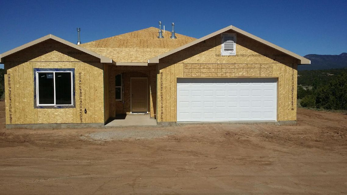 Views! Views! Views! New Home under construction. On almost 2 acres conveniently located close to I-40 only 15 minutes to ABQ! This home offers a open floor plan, refrigerated air and great views from the master bedroom, dining room and living room. Could be possible for buyer to pick interior wall color and flooring style