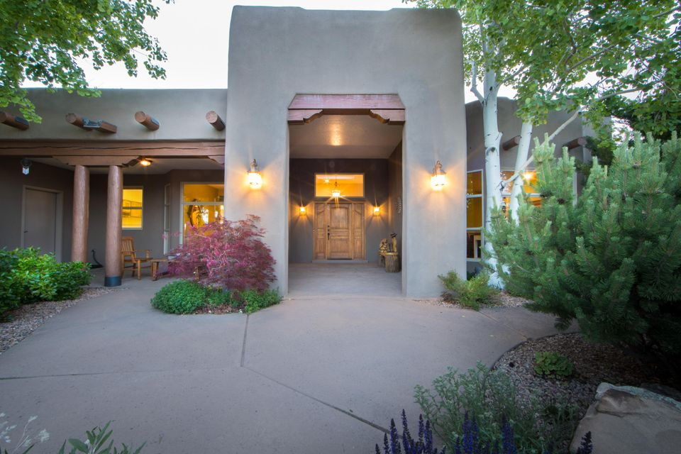 Southwest Presidential Custom Home by Rutledge. This one of a kind horse property sits on 4.11 acres, which is all pipped and X-fenced. 4 horse stable/barn includes steel dividers, heated tack room, hay/tractor & storage room. (see documents for specs) Don't forget the Round Pen, 6-8inch fine sand & 50ft diameter. For your trailers or RV, 50x30 heated garage with 2 oversized automatic roll up doors and second story for extra storage or workshop. Includes 50amp breaker, 18ft ceilings & built in air compressor. In the main house, new wood floors throughout, Gourmet Kitchen w/ Halbert Custom Cabinets, Granite Island Countertop & all appliances. Master-bedroom includes 2 oversized walk in closets, separate shower + garden tub. Too many features to list, must see in person!