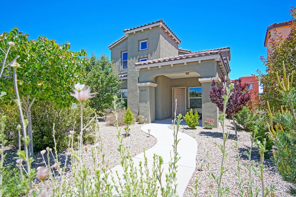 Beautiful custom Raylee home in one of the most incredible communities in Albuquerque - Mesa Del Sol!Enjoy the feeling of expansive space/views-13 minutes from Downtown Albuquerque, UNM & Nob Hill.This Build Green NM Silver home features 4 bedrooms & 3 full baths w/a bedroom-full bath downstairs for in-laws, guests or office.Open floor plan features gas log fireplace in living room,formal dining room & entertainer's kitchen w/large island,cherry cabinets & stainless steel appliances.Covered back patio w/gas grill & low-maintenance xeriscape in front-bank.Soak in mountain view frm spacious master bedroom upper deck!Laundry room conveniently located upstairs.Tankless water heater & refrigerated air. Neighborhood includes 4 parks, Pool Park, 1-acre Dog Park, Children's Playground.