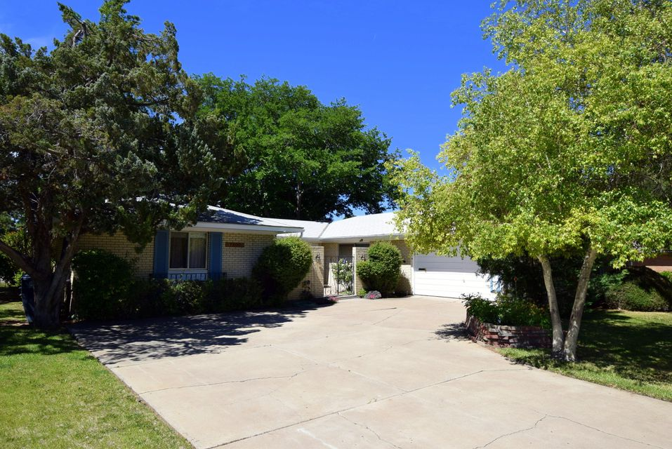 Price Reduced ! Desirable 1 Story MOSSMAN Charmer ! REAL HARDWOOD OAK FLOORS  ! Cherry  Wood Cabinets , Solar Panels  , Gated Front Courtyard Fountain  & Aspens  in the Park Like Front Yard !  As You Enter this Real Brick Home through the Gated Courtyard with Fountain and Rose Garden. You see the Large Family Room with Fireplace and Double Sliding  Glass Doors! That makes this room Bright !  To the right is the Large Formal Dining Room & Living Room Combination that Opens up into the Country Kitchen with Bright Sunny Window , Butler's Pantry Area & Wet Bar.  This Home Features a Large Master Bedroom with Private Bath and 3 Guest Bedrooms with  Hardwood Oak Flooring.  Beautiful Large Backyard with Raised Garden Beds, Covered Porch and many Shade Trees & Lawn !  2 Car Garage w/ Storage !