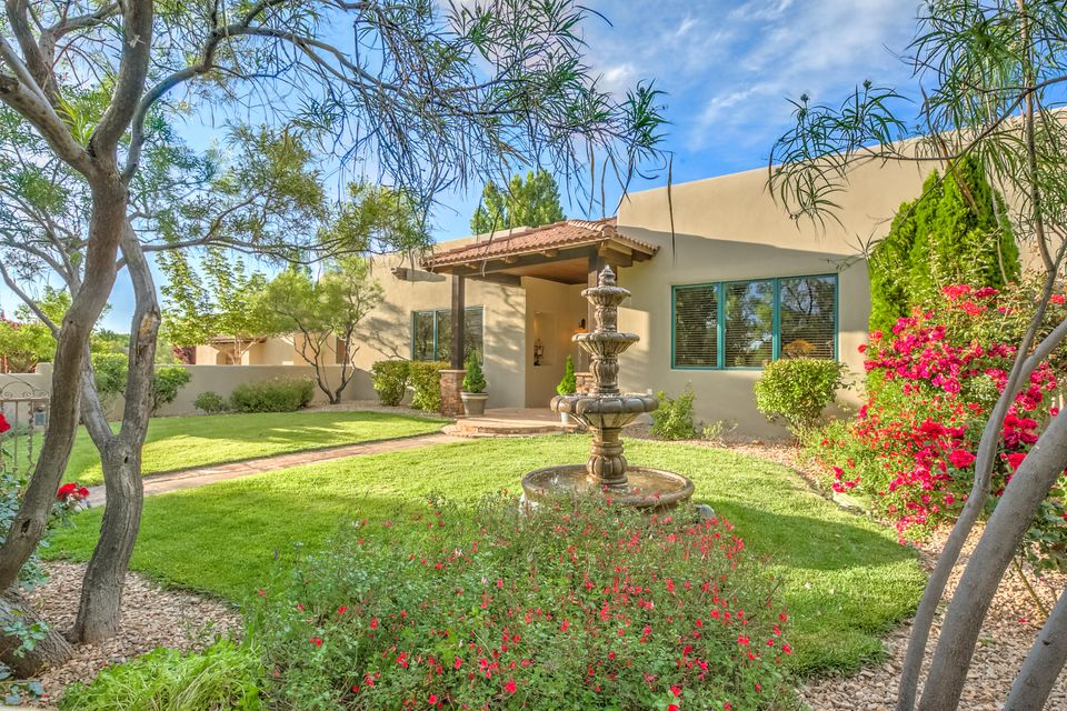 Exquisite Bosque Encantada property offers beauty, luxury and epitomizes the elegant charm of traditional New Mexican living. Surrounded by the beauty of the Rio Grande River.  Four generous bedrooms, 3 baths, large office, lots of dedicated storage. Ideal floorpan for active families and empty nesters alike. 3 distinct bedroom wings. Gourmet kitchen w/large island, granite countertops, breakfast bar, built-in refrigerator, walk-in pantry and extremely large laundry room w/ tons of storage. Open great room floor plan with a refined, sophisticated feel, Concrete & travertine floors, vigas, 12' ceilings, plaster walls, 3 kiva fireplaces-countless upgrades.  on over an acre, this stately property boast the lushest of landscaping, privacy and charming exterior spaces and finishes.