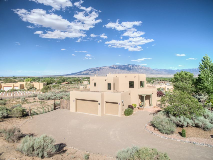 Captivating Mountain & Valley Views Abound from this Beautiful Corrales Property! Enjoy these Panoramic Vistas from an Open Floor Plan framed by Expansive High-End Windows, all of which overlook a Well-Manicured Yard Space defined by Sweetly Designed Exterior Walls & Gates. Experience a Wonderful Blend of the Southwest & Contemporary with Soulful Brick & Wood Flooring complementing Granite Countertops Everywhere, Stainless Appliances, & an Inviting Color Palette. This Well-Maintained Gem includes Newer Stucco, Cooler, Appliances, Roof Updates, & Well Pump as well as Nearly $100K in Improvements. All of this residing on a Private, Flat, Fenced Acre with Fruit Trees. Soothing, Comfortable, & in Sparkling Condition, make this Spectacular Home Yours Today!
