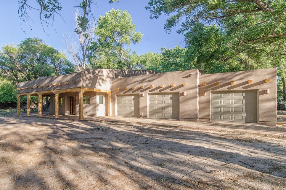 Your own private forest surrounds you at this outstanding home located at the base of historic Tome Hill. Situated on 1.6 acres of mature trees and lush landscaping, this completely remodeled 2-story is like nothing you've ever seen.  The custom wood-door opens to dramatic high ceilings and open living area with a craftsman stone fireplace.  The downstairs master with luxurious master bath opens up to a private patio.  A downstairs office lends itself to an optional 4th bedroom.  This house has been redone with exceptional care and quality.  Come see your spacious hideaway today!  You will never see another one like it! Seller will provide a $2,500 flooring allowance to an acceptable offer to finish the unfinished flooring.
