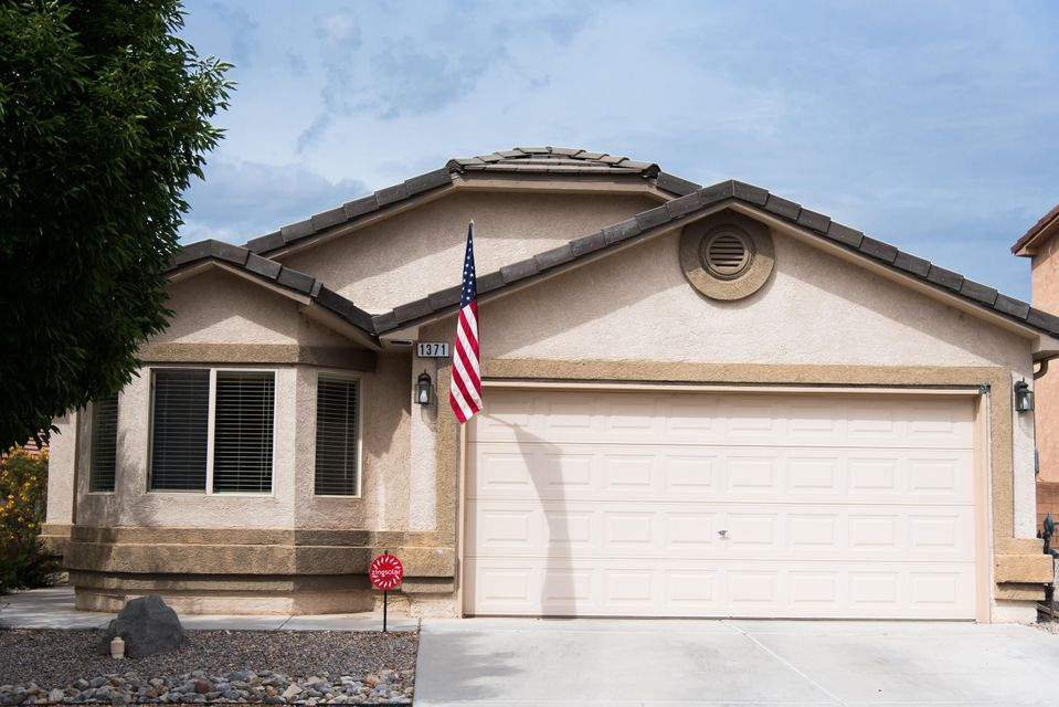 ******$1200 Flooring Allowance****** Get ready for summer in this 4 bedroom home with an over-sized refrigerated air conditioner, lush green backyard with a vegetable garden, and beautifully covered back patio.  This home also has a reverse osmosis water.  All appliances stay in this spacious home.  This home has solar panels which greatly reduce the electric bill in these NM summers.  This 12-year-young home also has an alarm system to top it all off.  Come to Astante at Cabezon and check out this beauty.