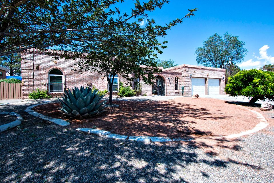 Remodeled home in Panorama Heights featuring 3 living areas, remodeled kitchen with ceramic tile, formal dining, large secondary bedrooms, spacious master suite, recreation room with bar and built-in storage, family room has fireplace, separate laundry room, over-sized garage 25x24, RV access on side of home, court yard with water feature/pond. Newer vinyl windows and room to roam on large lot.  Priced to Sell!!!
