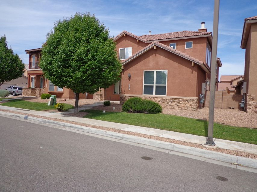 This Beautiful Home is a must See.  Home has large Master Downstairs with Large Bathroom with Sep Shower and Roman Tub, Vaulted Ceilings in Living Room with Wood Burning FP, Office and Large Laundry Room Downstairs. Jack & Jill Bedroom Upstairs that share a full bath. Large Loft and anther Bedroom with a full bath right next to it. 2 Car Garage Great Views of Sandia's from upstairs front bedroom Window.