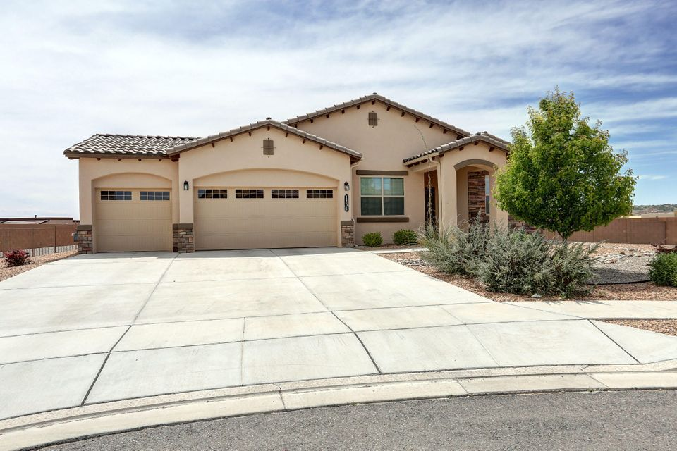 This Amazing property sits on a Spectacular Premium Lot that makes you feel like your the only house on the Block. This Remarkable Home has a popular open floor plan with over 40K in upgrades that was built for fun & entertaining.Come and preview the many upgrades from the Cooks Dream Kitchen to spacious Living area w/ Custom Fireplace to the Large Picturesque Window Doors that opens to a Relaxing covered Patio.Be prepared to be impressed with Granite thru out,Custom Tile Floors,Stainless Steel Appliances, Upgraded Wood Floors in the Formal Dining and Office,Tank less water heater & 3 Car Garage and so much more. The big back yard looks over parts of Rio Rancho and its Beautiful Sunsets.Possible RV and Backyard access. Enjoy the nearby park & community pool and shops near by. Amazing find!