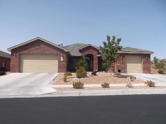 Gorgeous brick, 5 bedroom, 3 bath, 3 car garage, 2959 sq. Ft. Pulte home on a corner lot in Cabezon's gated community.  Nice open floorplan with 9 ft ceilings, 20'' x 20'' ceramic tiles, and 1 yr old carpet.   As you enter the home you are greeted by the formal dining room with laminate wood flooring and the living room.  Straight ahead is the beautifully designed kitchen with granite countertops, large pantry, built-in oven/microwave combo, newer dishwasher and lots of cabinets for extra storage.  The Great room has a gas fireplace and built-in area that can accommodate a large entertainment center.  New Anderson rear sliding door gives you access to the low maintenance back yard.  Relax in the master retreat