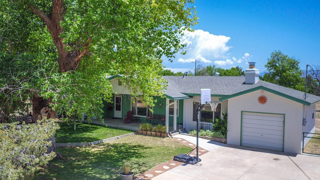 Plenty of space for all the toys and the horses!  This is a roomy parcel with a roomy house and a roomy shop to go along with it!  Directly off Marquez Road, virtually no dirt road driving, only a small section to the driveway on this well constructed older home nestled in the green belt.  Plenty of shade from the established trees and plenty of green to look at.  Creative home that offers an open kitchen with custom cabinets, sunken living room, and a spacious master suite.  Come take a look you will like this one!
