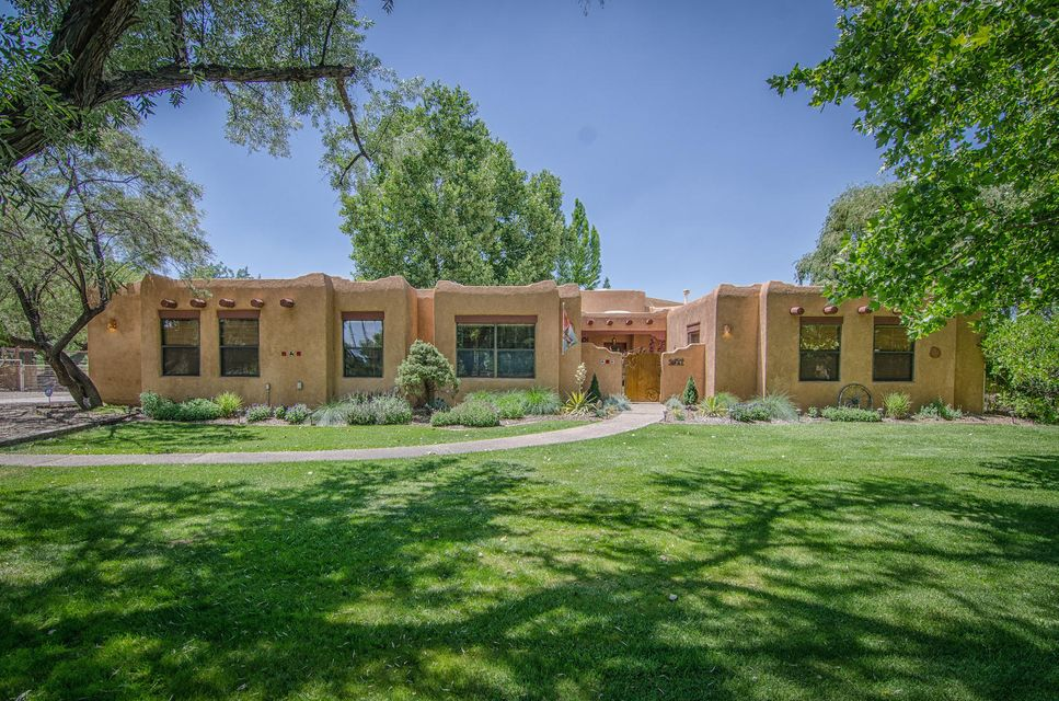 Live life in Paradise...with horses! Stunning home with classic Southwest style on a lush, one-acre horse property. Green oasis on a quiet & private cul-de-sac. Enter through a gated courtyard to discover the beauty of this home. Recent renovations include all baths and kitchen, engineered hardwood floors in bedrooms, hallway, offices & living room.  New light fixtures, new hot water heater, 2 new coolers, and complete new stucco. Chicken run has been extended with new chicken coop. Fabulous horse facilities. Gorgeous landscaping with lush lawn & mature trees.  Easy access to I-25, 30 minutes south of downtown Albuquerque, 20 minutes from ABQ International Airport. Bring your horses, chickens & the family---they will love to call this Home!