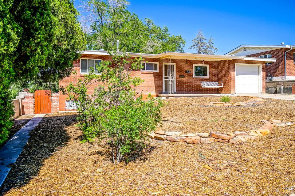 Super cute brick home with tons of possibilities. The 1000sqft walkout basement could be used in a multigenerational situation, man cave, home based business OR you could use the space for an AirBnB with it's separate entrance! The kitchen has been updated, hardwood floors refinished, newer windows and cold refrigerated AC to keep you cool on hot New Mexico days! The backyard is HUGE and like having your own private park. Relax under one of the huge shade trees while eating fresh grapes from the vines in the back. Close proximity to the golf course, UNMH, UNM, and CNM! Come by and see this wonderful find!