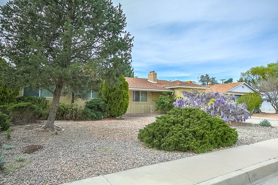 Located in the heart of Albuquerque, this updated Mossman home is convenient to downtown, UNM and Uptown. Gleaming hardwood floors, signature Mossman vaulted wood ceiling and a fireplace welcome you. The Kitchen has updated cabinets, granite counter tops, tile flooring and stainless steel appliances. This home offers lot's of space to entertain with 3 living areas or make the recreational room into an office, hobby space or 4th bedroom, it has a closet! The huge laundry room could double as a pantry(not included in SF). The large master suite offers tons of closet and storage space! Large windows plus skylights make this beautiful classic Mossman built home light and bright. Low maintenace landscaped front and back yards. The neighborhood is loaded with mature trees for treasured shade.
