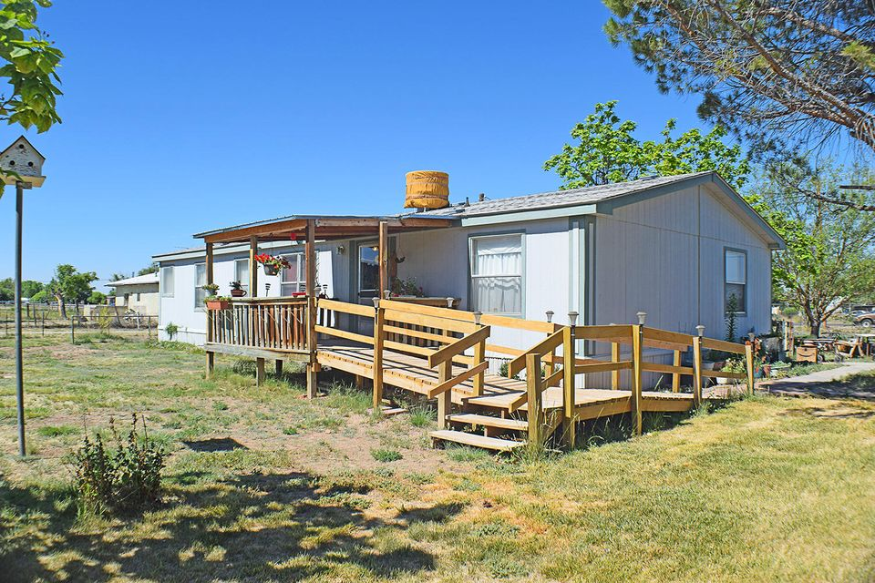 Charming manufactured home on over an acre and a half.  The home is 4 bedroom and 2 bath with an addition that is used as a mud room and refrigerated air.  The property has a big workshop, irrigation well and recently updated septic system.