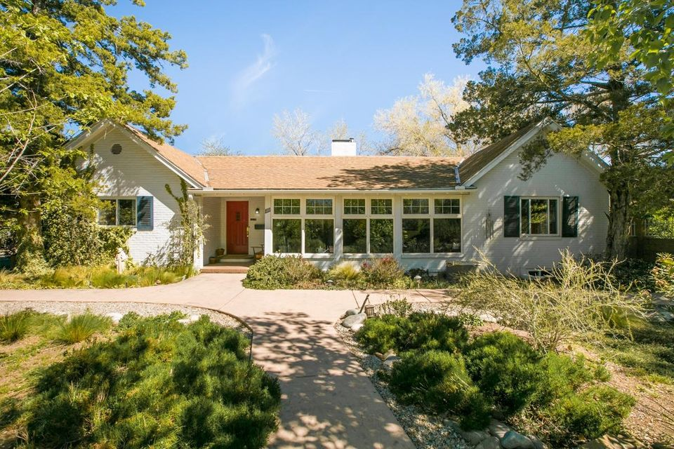 Own the Stromberg house - a piece of Abq history! This home sits on a verdant .6 acre lot in desirable North Valley neighborhood of Los Arboles. Well-maintained home with coved ceilings, recessed lighting, custom paint, & wood floors (tile in kitchen/bathrooms). Updated kitchen & bathrooms. Bright, light-filled rooms accentuated by elegant character & charm. You will love this beautifully landscaped property made private by mature greenery front & back. Excellent location close to the Bosque, Range Cafe, Flying Star, Starbucks and More!