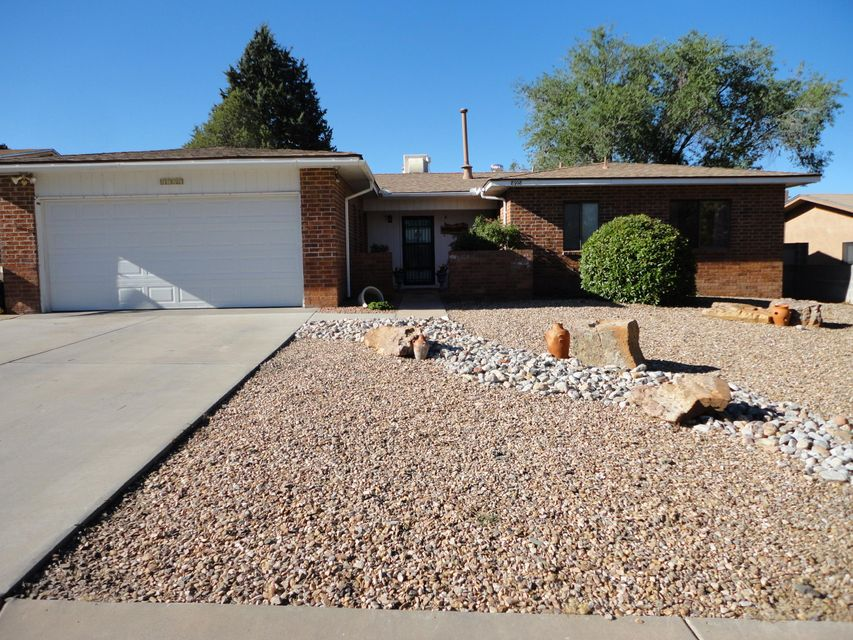 Come check out this updated 3 Bedroom with an office house in the Heritage Hills Neighborhood.   There is a media room that has a HD projector for entertaining.   The Master Bedroom Bathroom just got updated.   Xeriscaped front yard and spacious backyard with grass. Located in the La Cueva School district.
