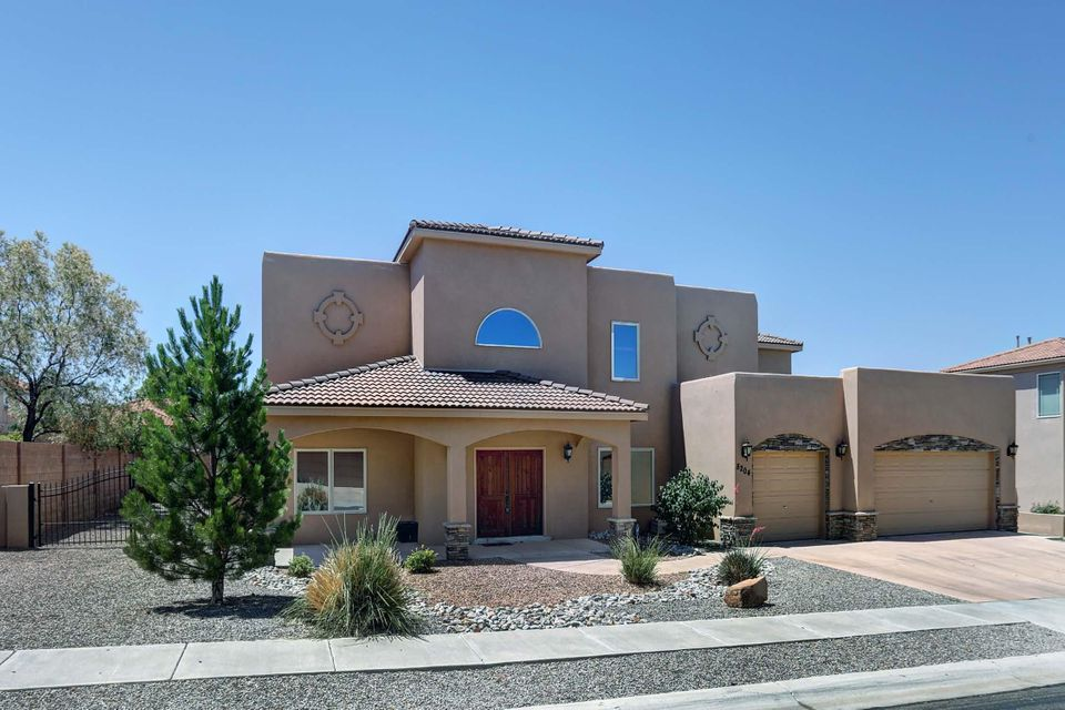 Captivating Mountain Views in Gated Quivera Estates! Custom Upgraded Home,4 Bdrm,4 bath. Front Den/office with 2 closets, possible 5th bdrm. Cathedral ceiling in Foyer, hardwood stairs. Family Lv rm w/custom gas log frplce, Kitchen & Brkfst nook overlook back patio. Gourmet Kitchen w/tile backsplash & countertop bar seating, Granite counters, SS Appliances, Refrig, Huge pantry, 5 Burner gas cooktop/double oven, upper convection. Wet bar w/cabinets. Custom window blinds T/O. Master Suite includes sitting rm w/gas fireplace. Stunning master bath, dual sinks, snail shower, jetted tub & walk-in closets. Finished 3 Car Garage, rm for storage or 'Big Boy Toys'. Fully landscaped yards, east side wrought iron gate. Spacious covered back patio. Beautifully Maintained, Move-in Ready Home-Must See!!