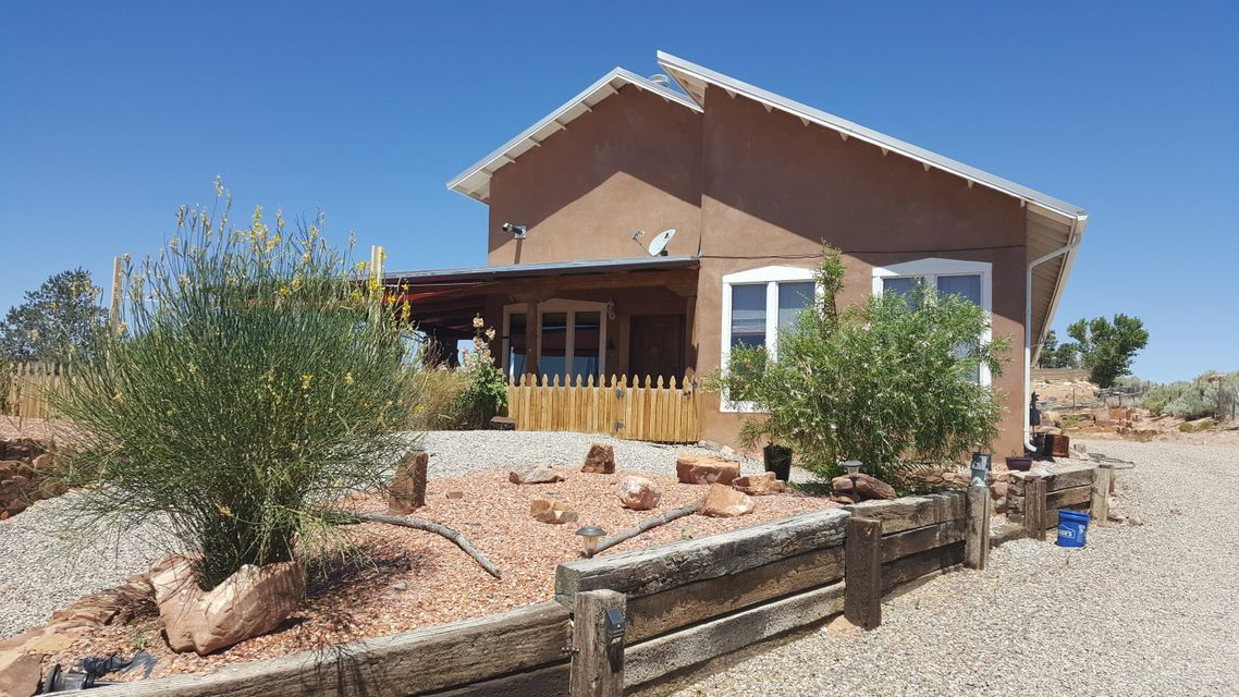 This is a Beautiful adobe home with the best views of the Sandias --On top of it all. 4 bedrooms 3.5 baths, brick floors, dining and 2 living areas with a loft for college kids or office,vigas,huge covered porch/VIEWS Garage can be added to specs.VIEWS VIEWS VIEWS