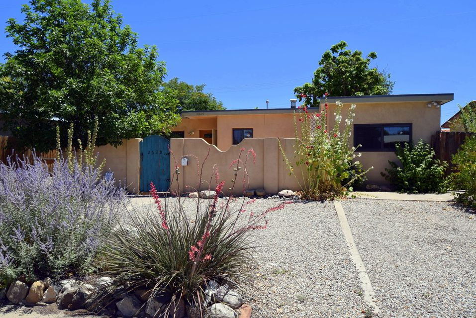 This charming little gem is move in ready with lots of updates.  Featuring a spacious floorplan with updated kitchen, wood floors, updated windows, refrigerated air, a large private backyard & inviting front courtyard.  Enjoy the location of this cute & cozy home in the desirable uptown area at an affordable price. Don't miss this fantastic opportunity to own such a well maintained & darling home.  It's the perfect place to hang your heart!  3rd bedroom is the converted garage or it can be used as a den/study.