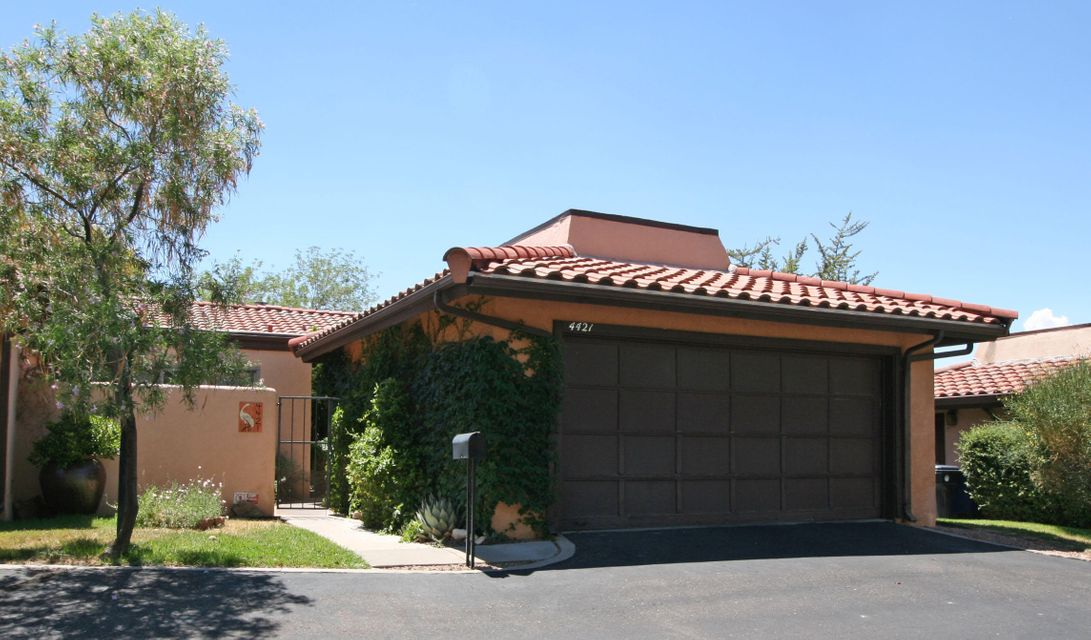 The wonderful courtyard welcomes you to this Bright & Cheerful Shadow Hills former model! Almost all flooring just replaced ($10k). Two large MASTERS, both w/ full baths. Open kitchen/dining room over-looks 2 living areas. Double sided fireplace & a wall of windows that bring the outdoors; IN! Private, peaceful patio-the sunsets & city light views are AMAZING! Instant hot water system serves the Jacuzzi tub in the luxurious master suite. Newer patio doors & windows w/ internal blinds.  Newer: water heater & HVAC system. An over-sized 2 car garage w/ room for cars AND storage. Just minutes from grocery stores & walking/biking trails. Close to Highpoint Sports & Wellness, Dog Park & the bus line. Beautiful home - easy living. Come check it out!