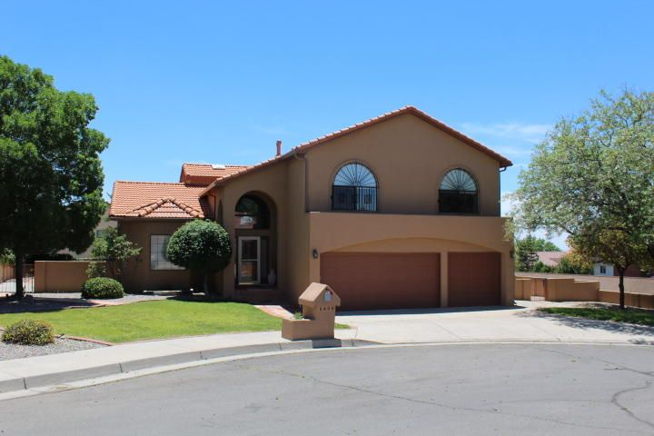 Highly sought after Vineyard Estates located in the La Cueva School District. Home features a dramatic entry to open living area with cathedral ceilings and spiral staircase. Formal dining room has plenty of natural light through clerestory windows.  Enjoy the spacious kitchen with granite countertops some new ss appliances. Breakfast bar and nook open to family room featuring a gas log fireplace and built in shelving. Possible 5th bedroom/office/study located downstairs next to bath with shower. Master Bedroom has a large walk in closet with built in drawers, en-suite bath has a large jetted tub, double sinks and a vanity. Some rooms have california closets shelving. Upgrades in recent years include newer roof and gutter system, granite countertops in kitchen and baths, re-stucco, paint,