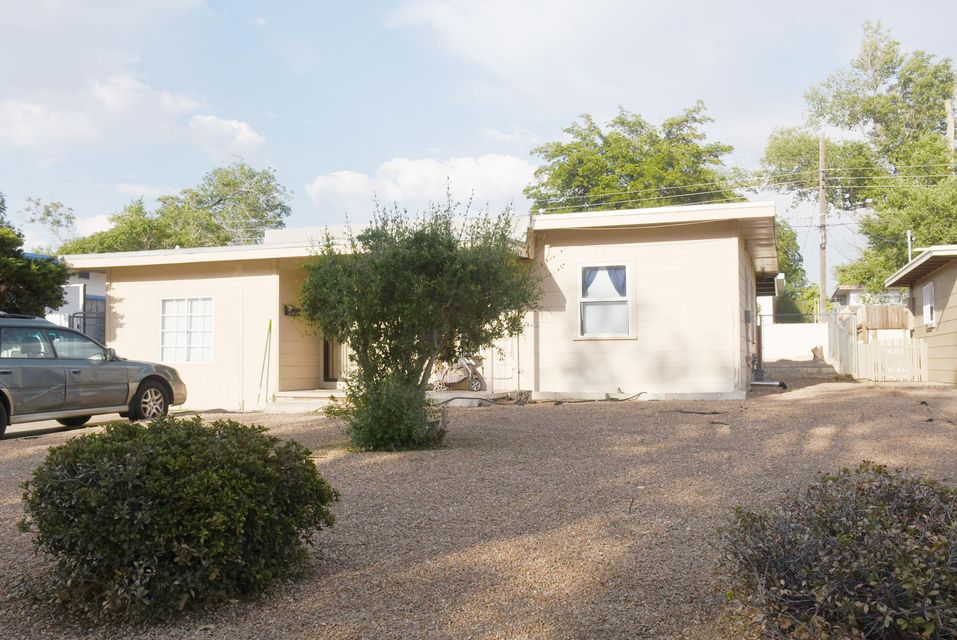 Location, Location, Location, remodeled kitchen with granite counters, and bath room, 3 bed rooms, 1 bath home, Refrigerated cooling, newer furnace.  opposite UNM Golf course, walk to UNM Med, law school, Hospital, close to whole foods. all appliances included