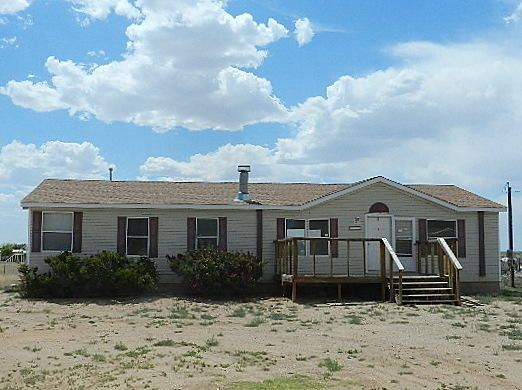 This 3 bedroom, 2 bath manufactured home is ready for a new owner! Spacious, open and light filled floor plan features a large kitchen with island and separate dining area. The master bath has both a shower and a large soaking tub. Located on an acre, there is plenty of room for hobbies, games, relaxing and entertaining.