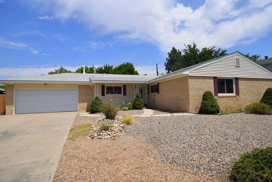 Lovely ranch home in beautiful NE neighborhood.   Updated kitchen, large living spaces and terrific backyard with hot tub.  Great house for family living and entertaining.  All appliances included!  Pre-inspected and professionally cleaned. Oversized garage with tons of storage space.  Private backyard, storage shed for yard tools, lush grass and mature trees.  Side yard access.  Ready for new owner!