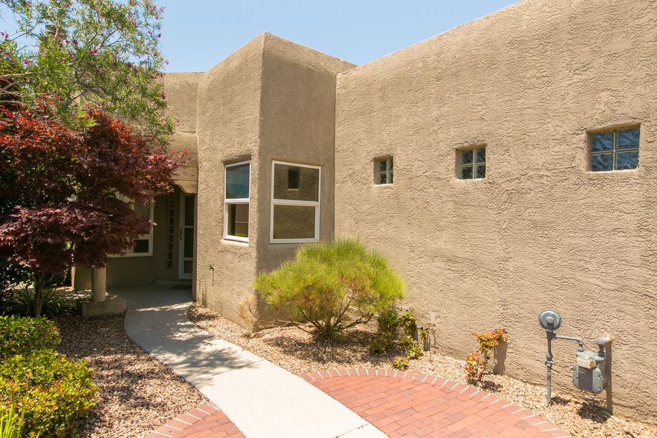 Located in HIGH DESERT on a quiet cul-de-sac you will find this 2 bedroom, 2 bath, 1450sqft town home with courtyard entry. Upon entry you are greeted by the light and bright Living Room with a Kiva fireplace and opens to Kitchen and Dining Room which is perfect for entertaining. Kitchen offers ample counter space for prepping, and plenty of cabinet space for storage. The Master suite offers a spa like bath with a Jacuzzi tub, large shower, dual sinks and a walk-in closet.  Private backyard with a pond and fruit trees. Great location, close to the Open Space Preserve. Wide doorways and lowered counter allows for wheelchair access.